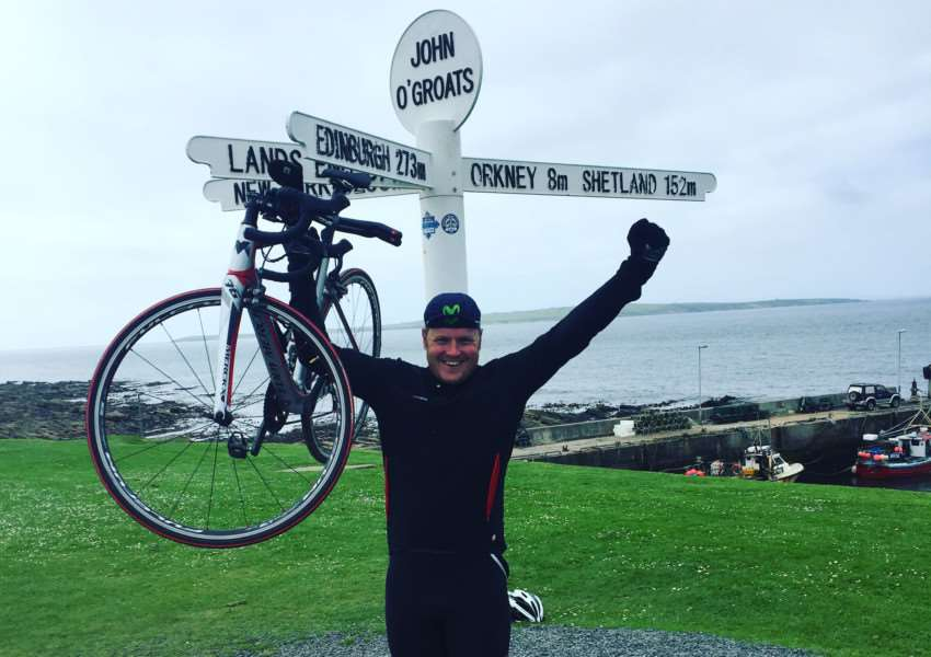 Ben Selby celebrates reaching John O'Groats after his 1,000 mile fund-raising ride.