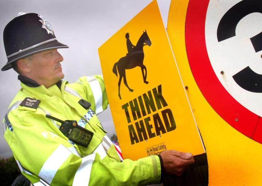Sergeant Paul Kear with one of the new Think Ahead road signs EMN-160615-091439001