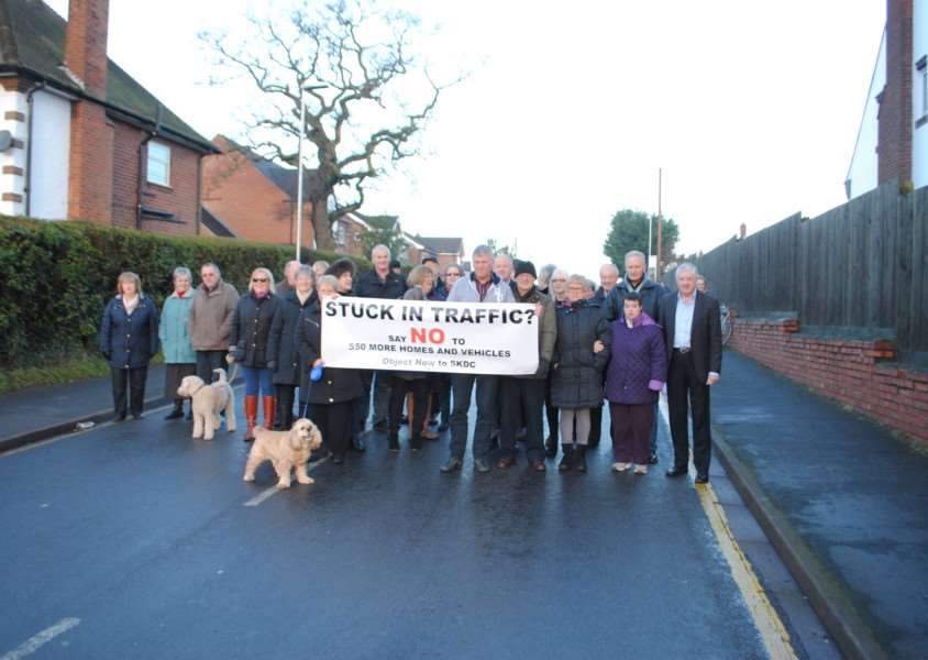 Residents with a banner protesting against plans for 550 homes at Manthorpe.