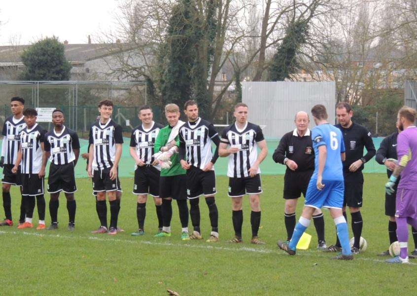 Harrowby United, in stripes, greet their hosts Thrapston prior to kick-off on Saturday.
