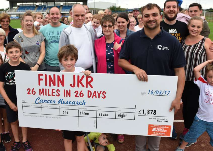 Finn presented a cheque for over �1300 to Cancer Research on Monday.