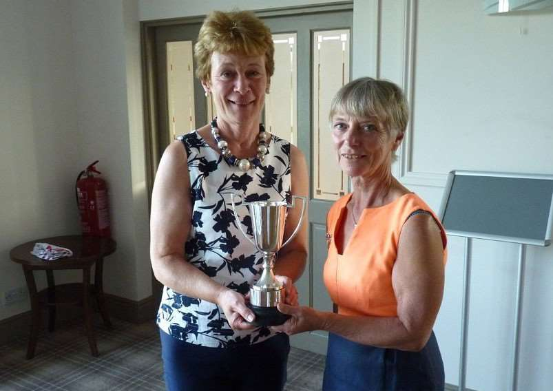 Winner of the Past Captains' Trophy Sheila Mason (left) receiving the trophy from present captain Sue Hall.