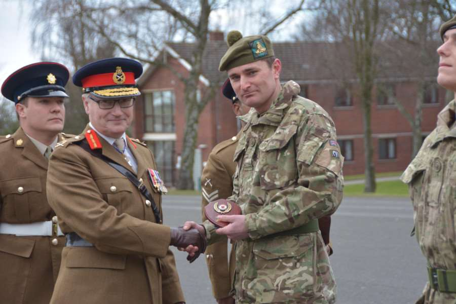 Army Training Unit Grantham passout Parade held at PWG Barracks Grantham reviewing Officer Major General S Brooks-Ward CVO OBE TD VR (pictured) Gnr Daniel Williams 212 Bty (highland) 105 Regt RA EMN-160203-103140001