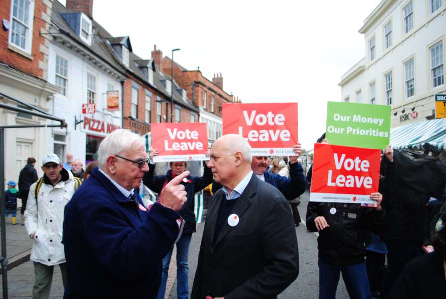 A voter gives Iain Duncan Smith his views in Grantham market.