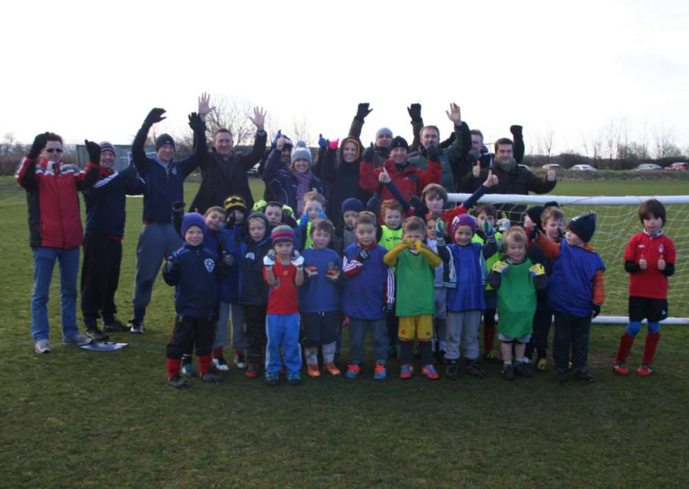 Players, parents, coaches and committee celebrate news of the FA grant.