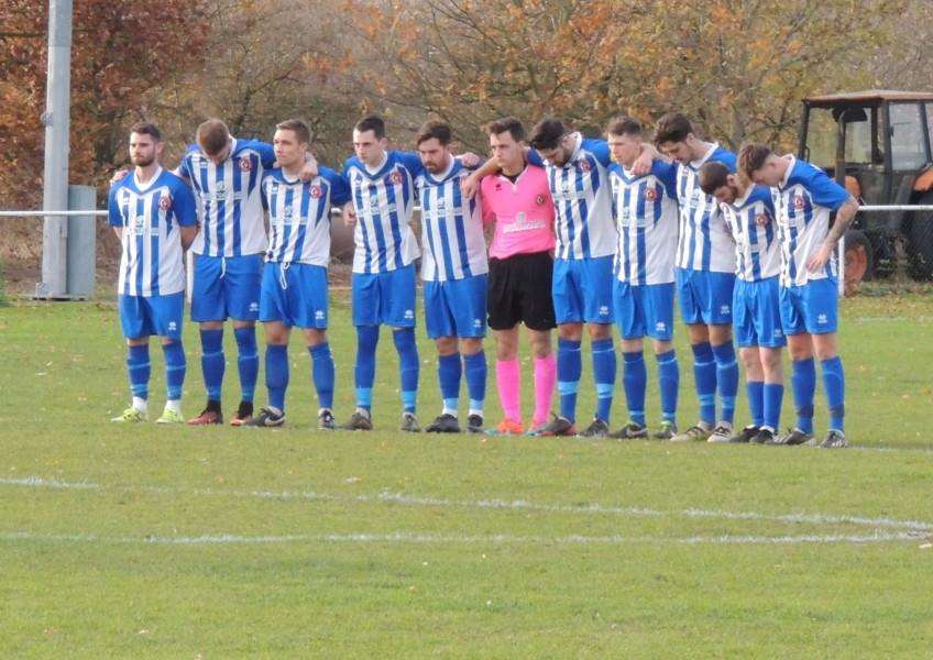 Harrowby players observe the minute's silence for Jeremy Biggs.