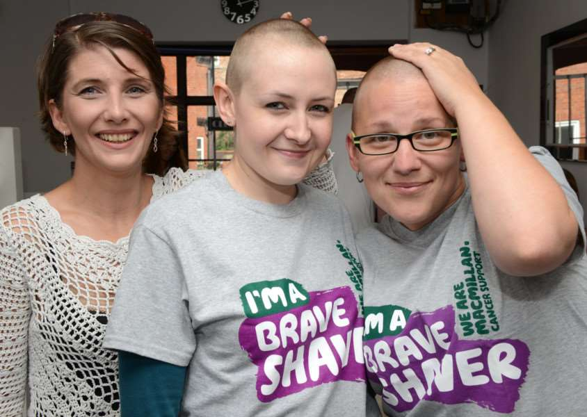 Heather Paddison, centre, and Natasha Holmes after their Brave the Shave with Toni Angeloni, of Toni's Barber Shop.