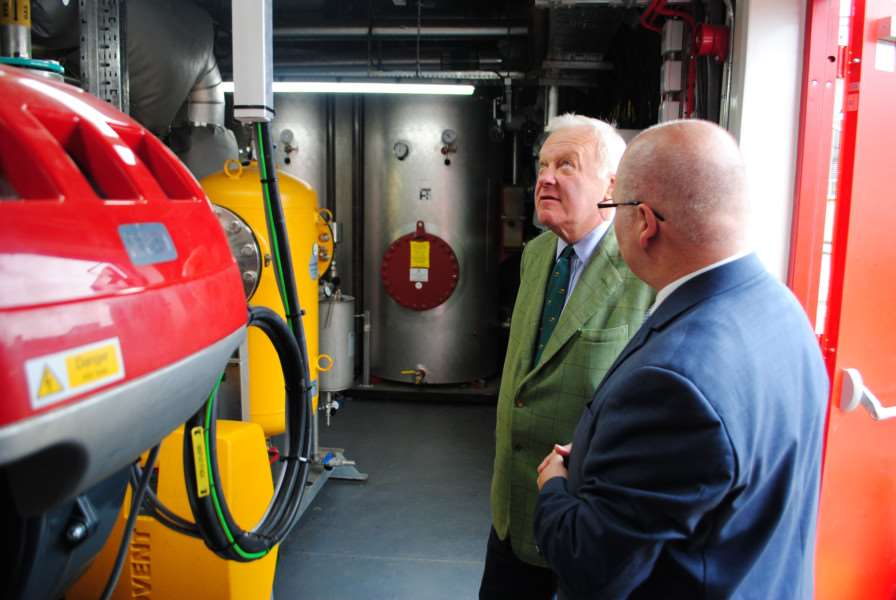 The Lord Lieutenant of Lincolnshire, Toby Dennis, is shown the new energy centre at Grantham Hospital by Facilities Manager Ian Hayden.