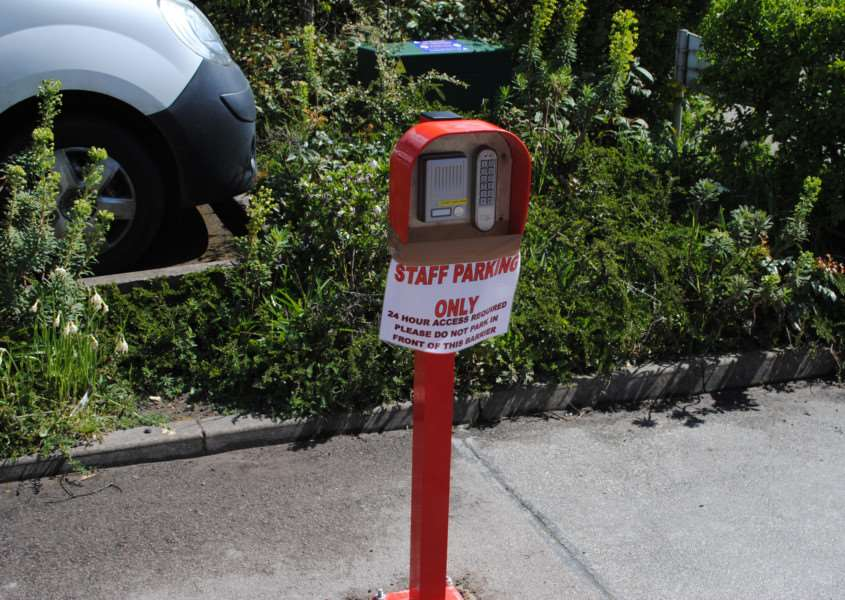 Signs on the car park's new call system inform patients it is now staff parking only.