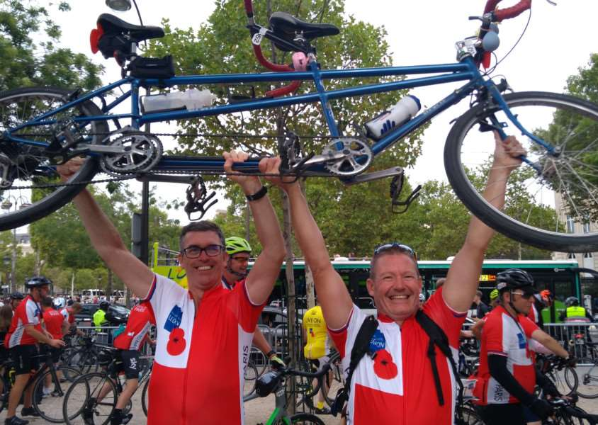 Mark Collins and Neil Baldwin celebrate completing the ride to Paris in aid of the Royal British Legion.