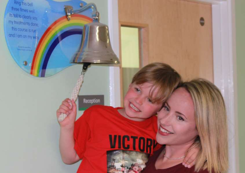Jacob rings the End of Treatment Bell with help from mum Eleanor