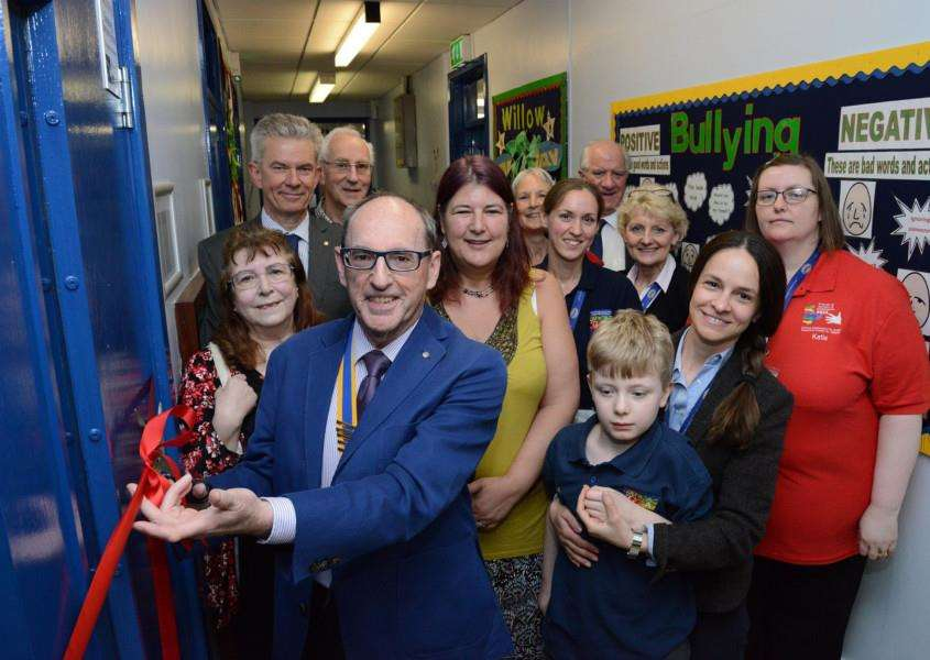 Alistair Holmes, President of the Rotary Club of Grantham, cuts the ribbon to officially open the new sensory room at Sandon School.