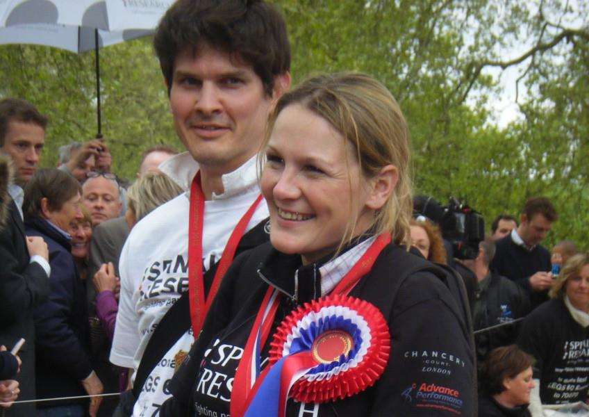An emotional Claire Lomas and her husband Dan Spincer after crossing the finish line of the London Marathon EMN-160501-164853002