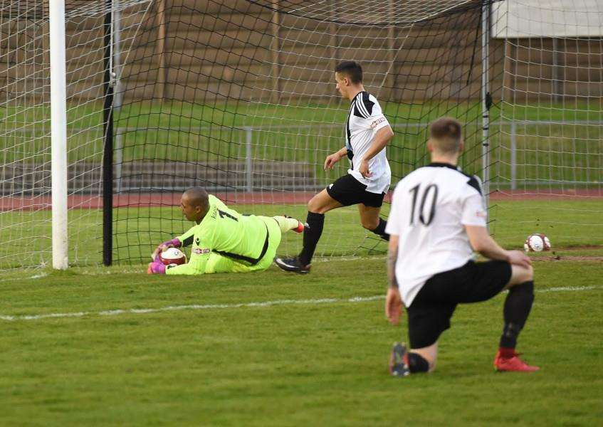 Pitmen keeper Jose Veiga smothers the ball from Sam Osborne in the first half. Photo: Toby Roberts