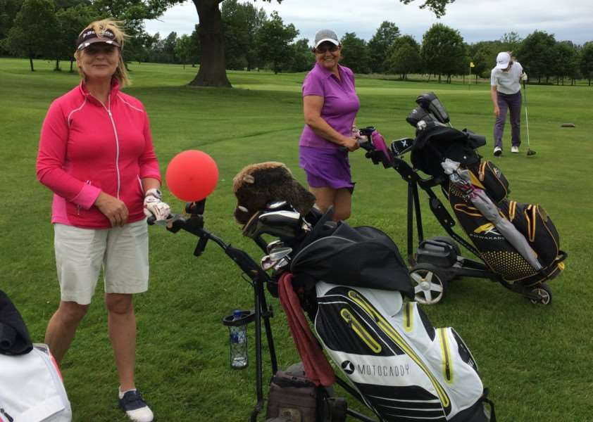 Caroline Hills with the balloon in the Belton Woods ladies' Texas Scramble.