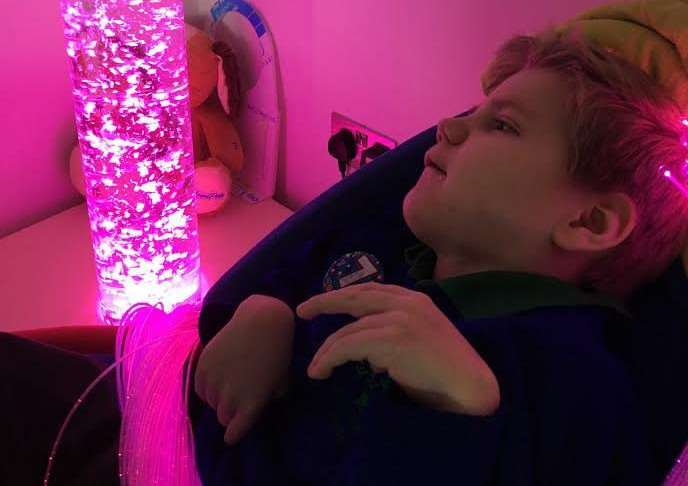 Alexander Needham enjoys his new sensory equipment.