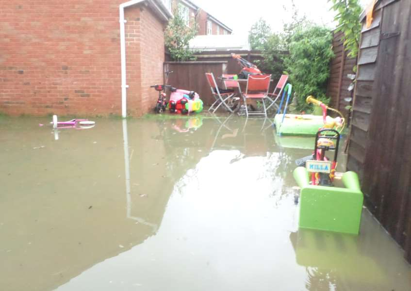 The back garden of Rebecca Henson's home in Cavendish Way was flooded.