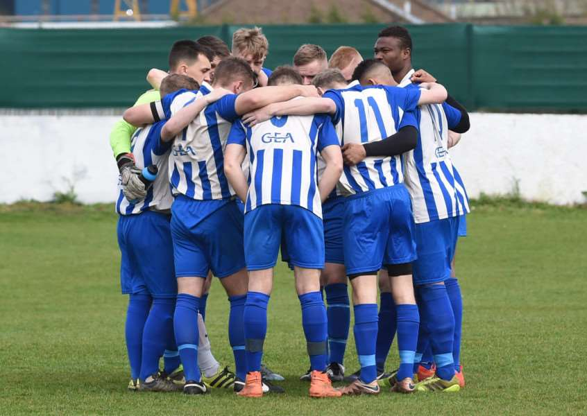 Harrowby United's pre-match huddle at Dickens Road on Saturday. Photo: Toby Roberts