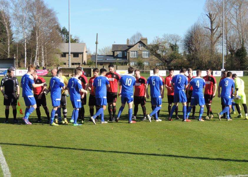 Harrowby United and Eynesbury Rovers shake hands before kick-off on Saturday.