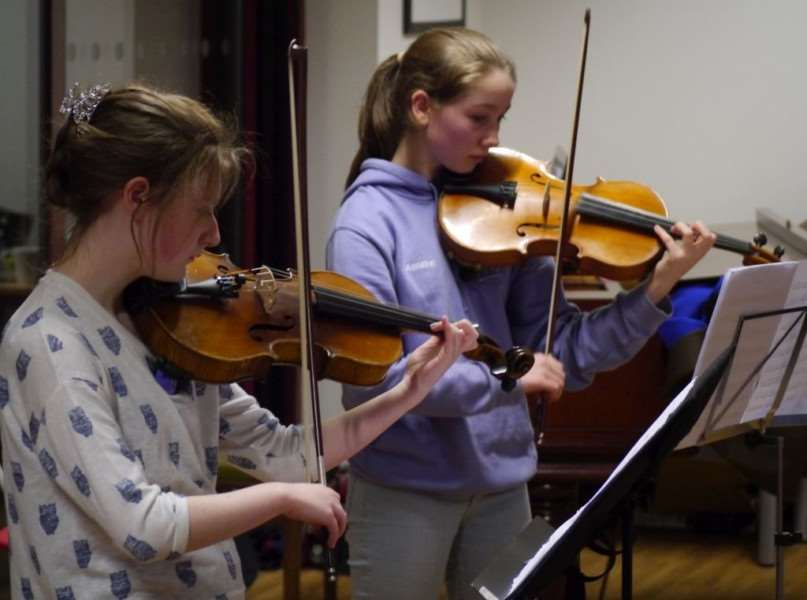 Violinists practise with the Oasby Music Group.