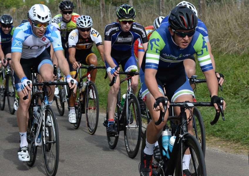 Witham Wheelers junior Adam Egner (centre) in the thick of the action at Castle Bytham. Photo: Alan East