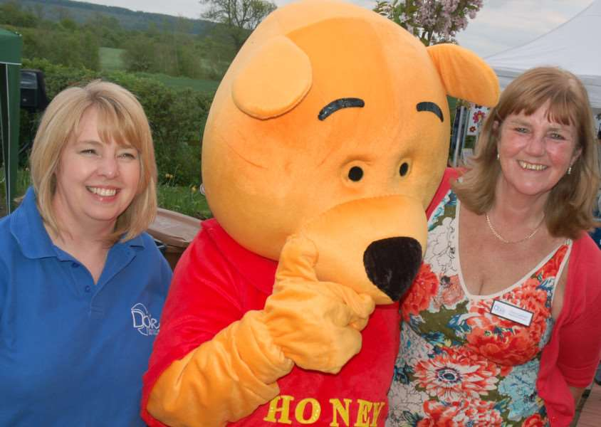 Dove Cottage staff Amanda George and Chris Gatfield meet up with Winnie the Pooh 'PHOTO: Tim Williams EMN-160516-163640001