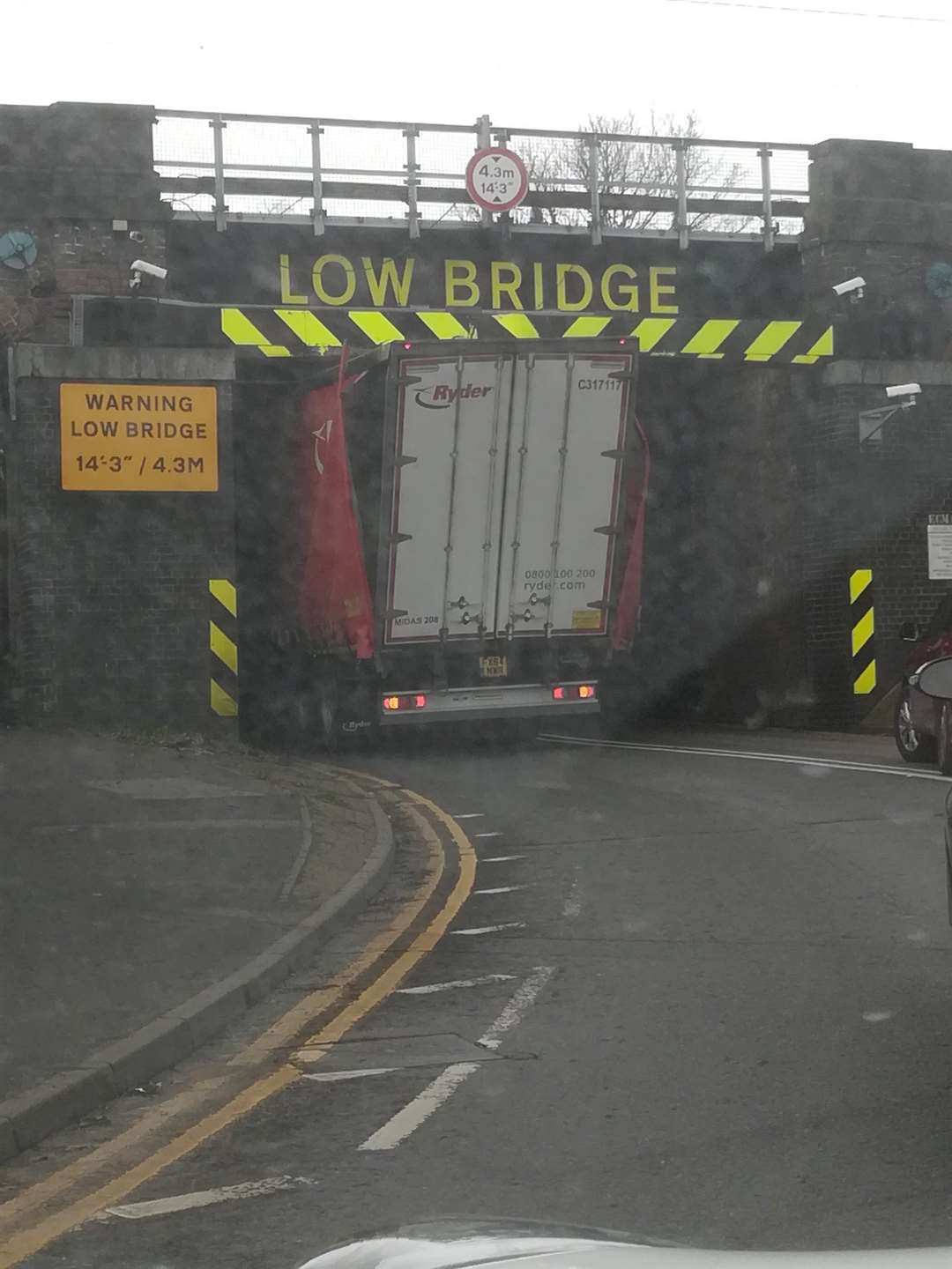 A lorry stuck under the bridge on Barrowby Road. (29216679)