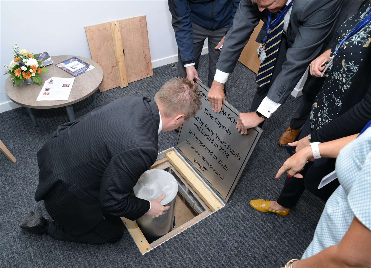 The time capsule was buried inside the school. (4181152)