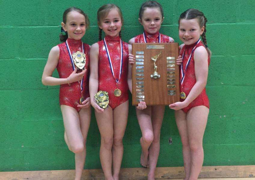 Under-9 girls winners Long Bennington are Molly, Emily, Grace and Jessica.