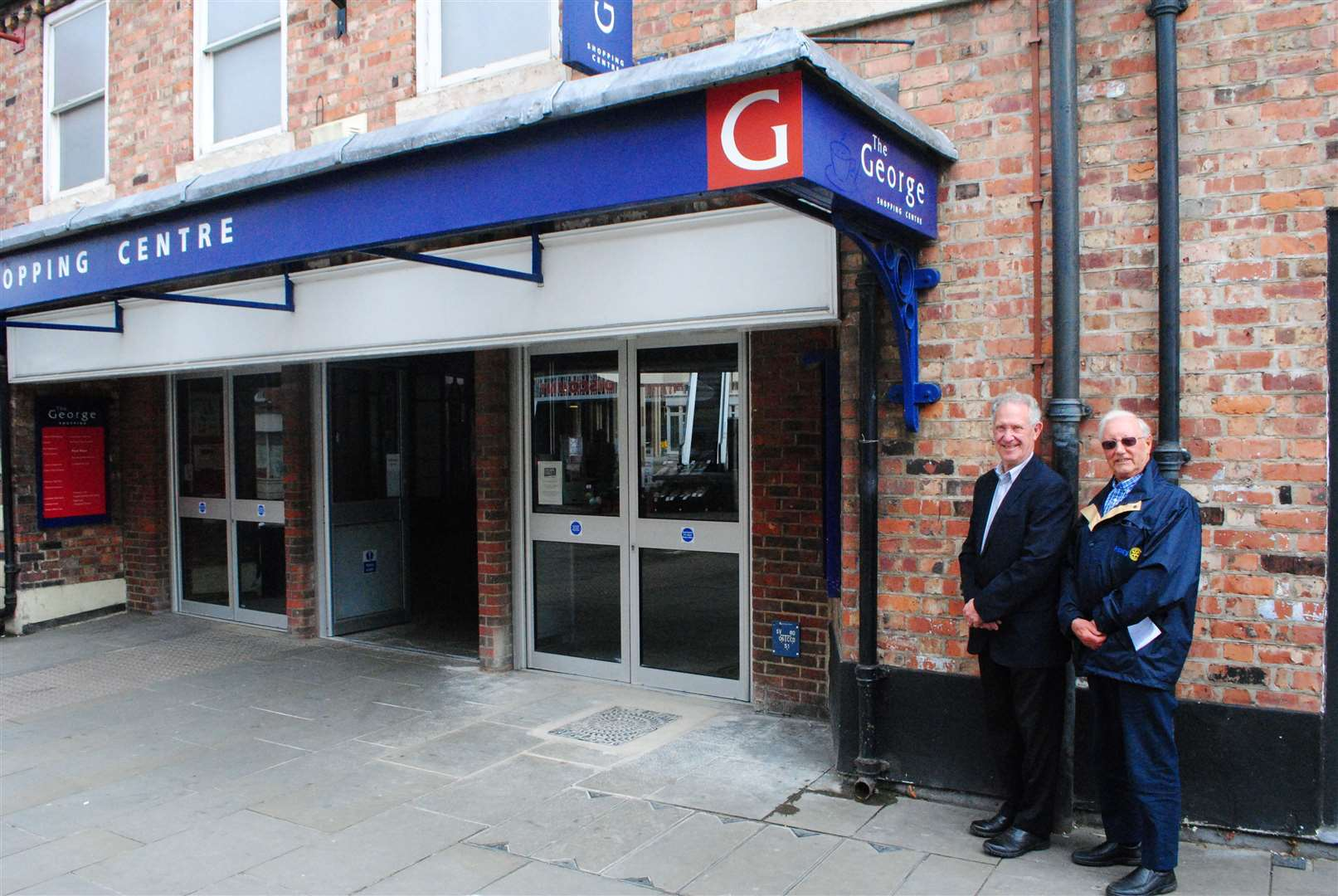 Rotarians Graham Smith and Mike Charity at the spot outside The George Centre where a defibrillator will be installed. (11375208)