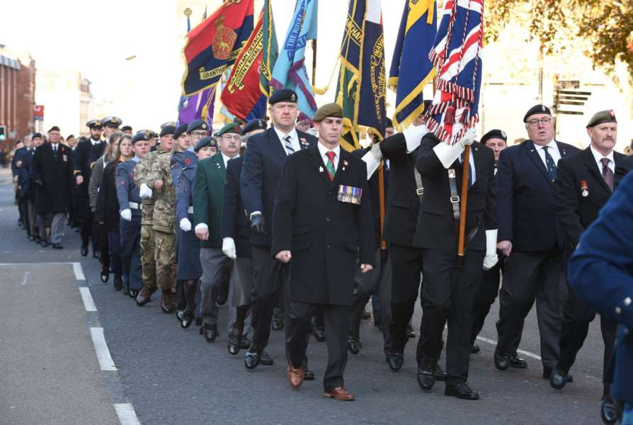 Standards were carried as the Remembrance Day parade made its way back from St Wulfram's Church on Sunday.