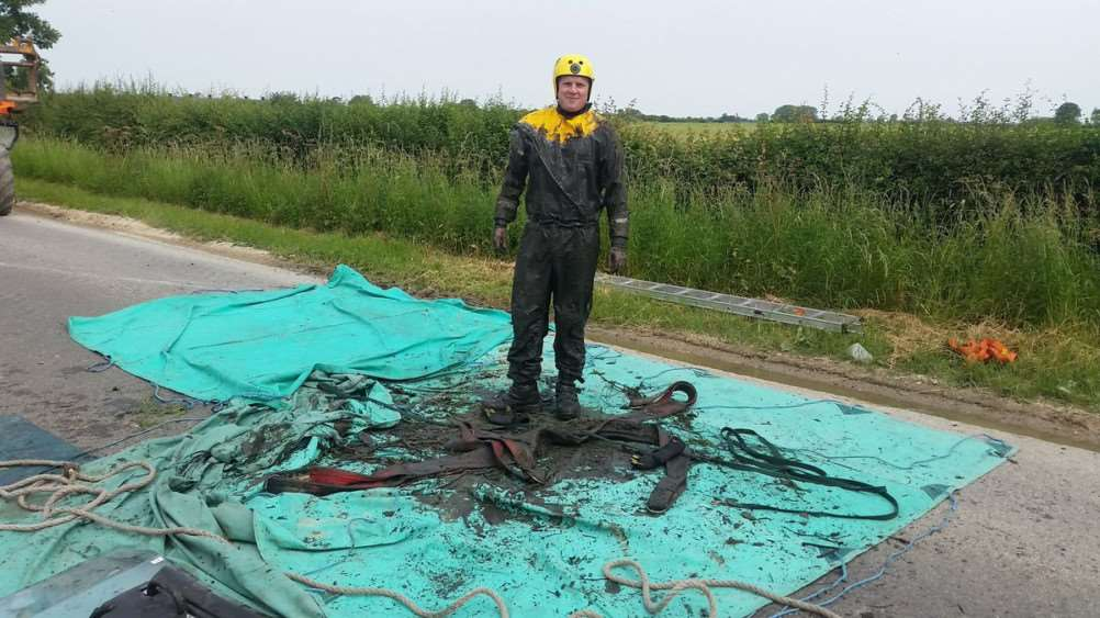 One of the firefighters after rescuing Teddy the horse from a ditch in Allington.