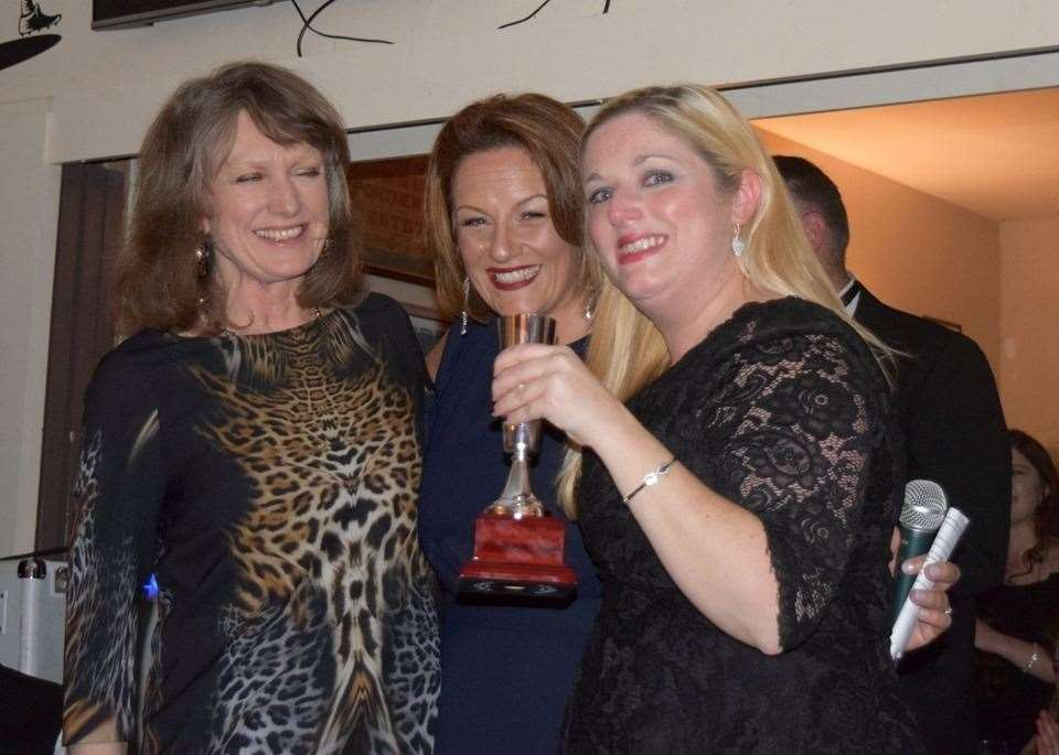 Ceri Wright collects her trophy from Belinda Smith, alongside ladies' captain Sarah Jane Goss. (10826244)
