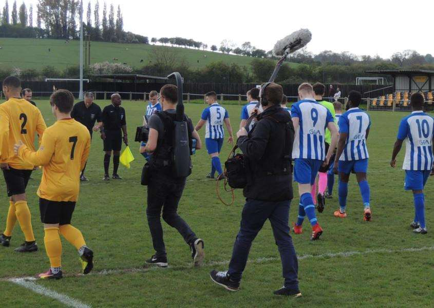 Harrowby United and Harborough Town prepare to do battle under the watchful eye of a film crew.