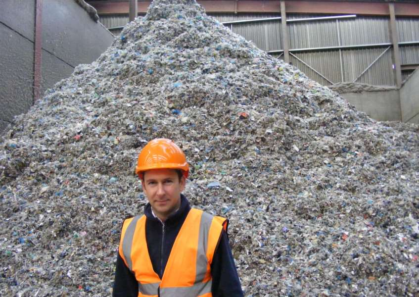Managing Director of Mid UK Recycling, Chris Mountain, with a heap of shredded textiles destined for recycling as fuel. EMN-150112-135243001