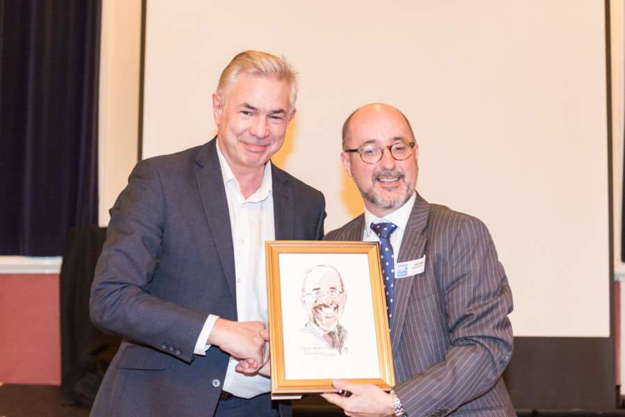 Managing director of Journal publisher Ilffe Media Richard Parkinson presents a framed caricature to Grantham Business Club chairman Andy Hodgson. Photo: Adrian Harvey