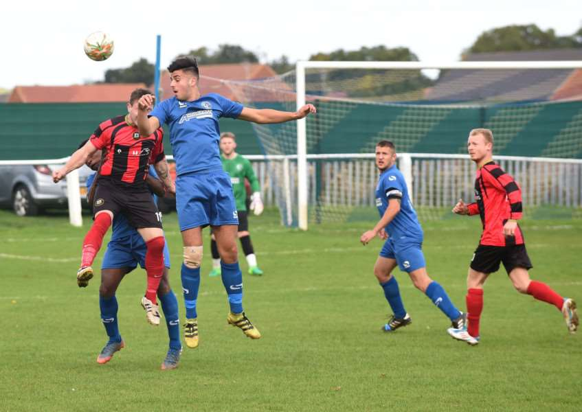 Action from Harrowby United's match against Huntingdon Town on Saturday. Photo: Toby Roberts