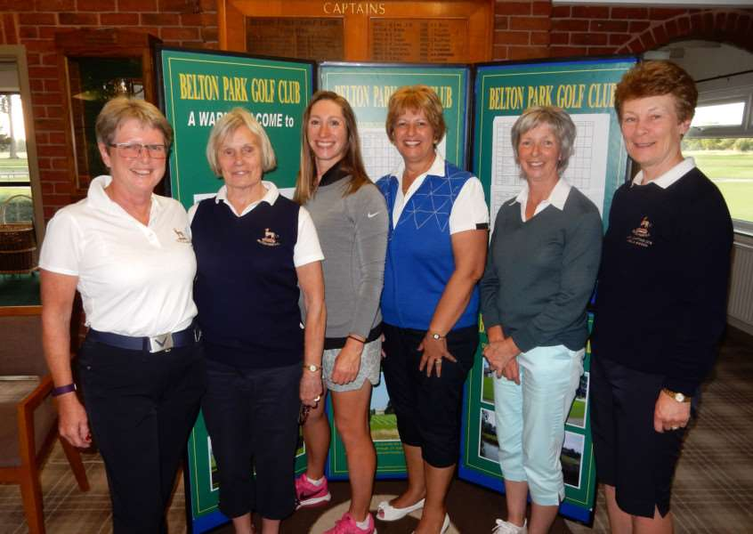 Competition organiser Sue Addis (left) and lady captain Sheila Mason (right) present prizes to the winning team of Ina Wood, Jo Pearson, Pam Wiggins and Pam Mackey.