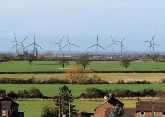 A picture of how the turbines at Fulbeck airfield might look if the plan were approved. Picture mocked up nby reVolt