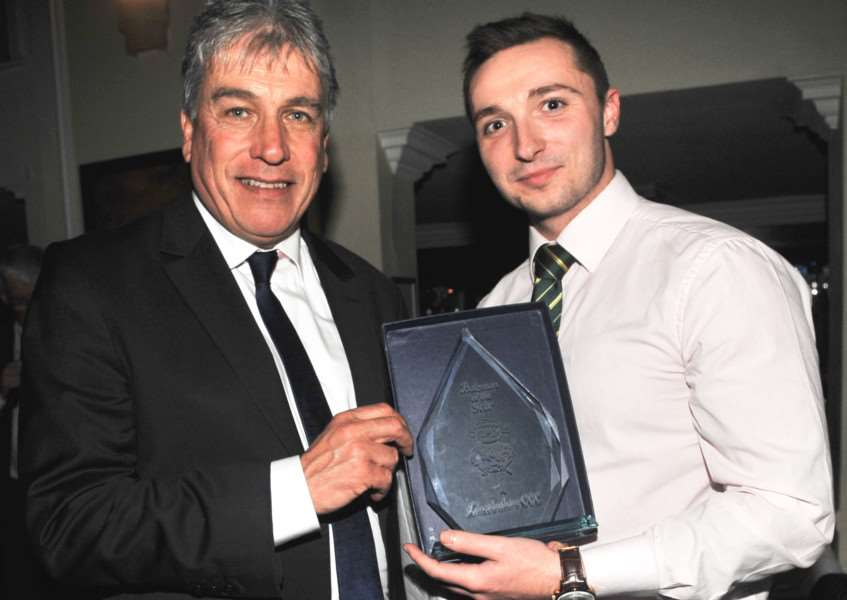 Dan Freeman receives the Lincs CCC batting award from the BBC's John Inverdale.