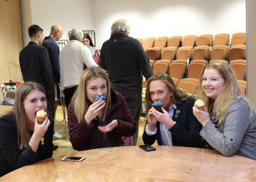 Enjoying the cakes on sale at Priory Ruskin Academy.