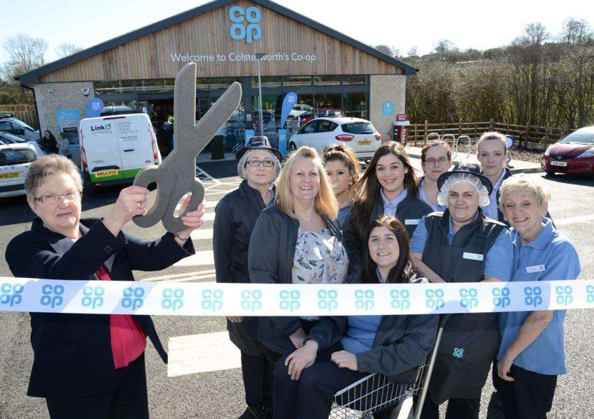 Wendy Vickers (retired former manager of the old Co-op) opens the revamped Co-op at Colsterworth. Photo: Toby Roberts