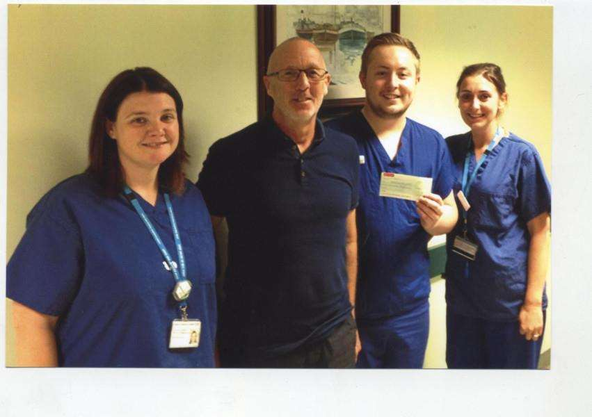 Arthur Whatley presents staff at Lincoln Hospital with �400 after receiving treatment there for prostate cancer.