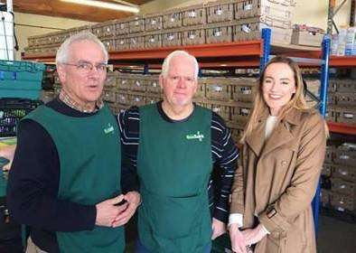 Charlotte Caithness, pictured with foodbank volunteers David and Richard, donated nine boxes of food and products to Grantham Foodbank last month.