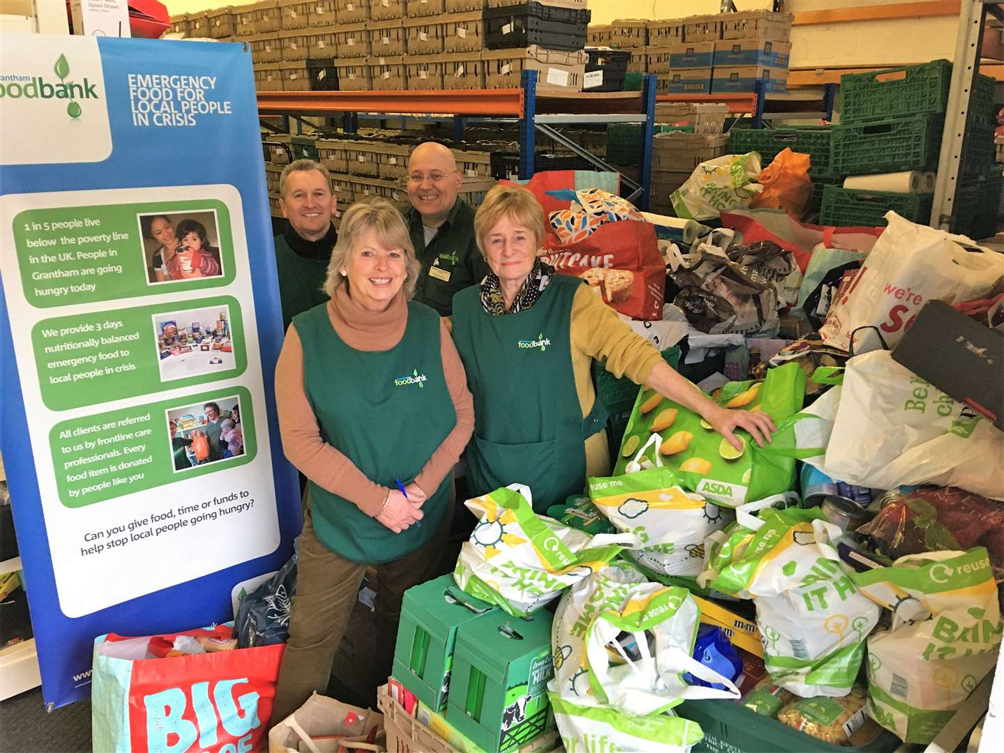 Grantham Foodbank co-ordinator Brian Hanbury (centre, back) with volunteers receiving the SKDC donation (24417487)