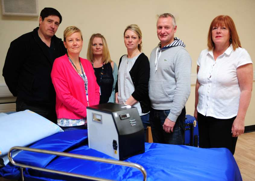 Equipment donated to the Kingfisher Ward at Grantham Hospital. From left, Steve Huggins, Angie Paulger, Eleanor Sherwin, Michelle Fardell, Dean Fardell and Julie Odwyer.