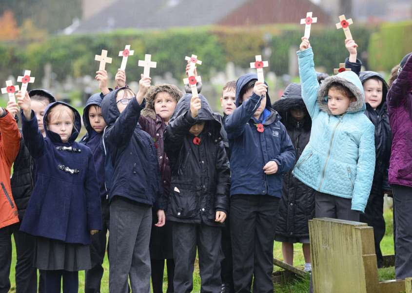 Remembrance service at Grantham Cemetery, attended by pupils of St Anne's Primary School.