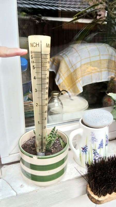 David Tibbett's rain gauge shows more than six inxhes of rain fell in the last 48 hours in Grantham. (12224911)