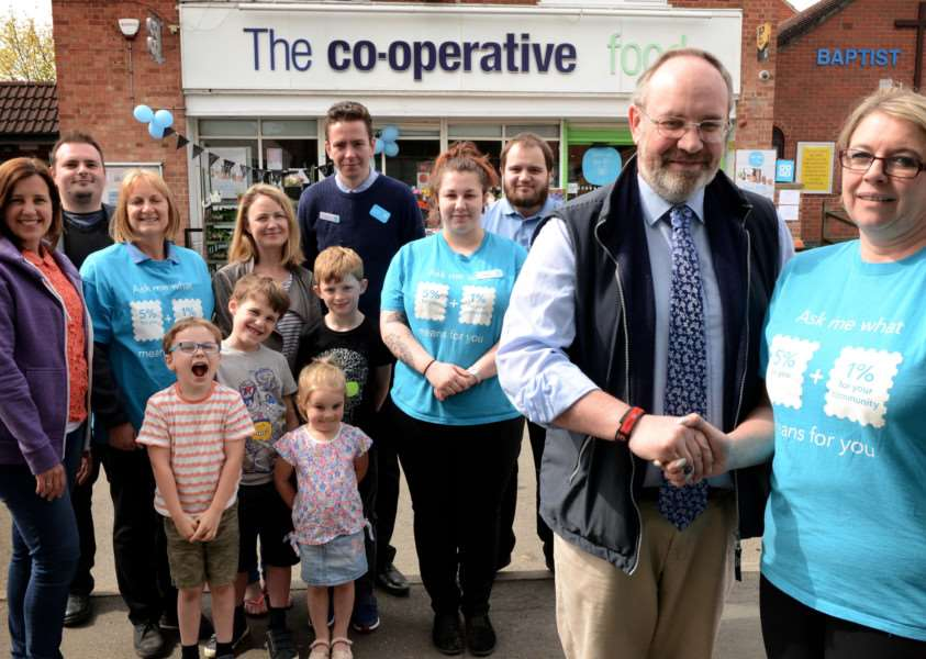 Bottesford Co-op supports Friends of Bottesford Primary School. Pictured front are Matthew Wright with the presentation by Dianne Gregory, of the 'Co-op.