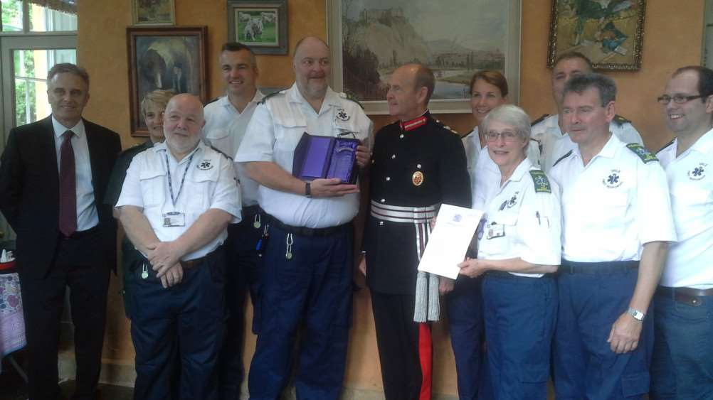 Sir John Peace, Lord Lieutenant of Nottinghamshire, presents The Queen's Award for Voluntary Service to the Vale First Responders.'Also pictured, congratulating the Vale First Responders, are East Midlands Ambulance Service's chief operating officer David Whiting (far left), EMAS' Mandy Lowe (second from left) and Anthony Belling (third from right). The Vale First Responders in the picture are Rowan Bird, Mark Onyett, Rod Whitehead (chairman), Lesley Onyett, Gill Clark, Peter Savage and James Buck EMN-160509-134310001